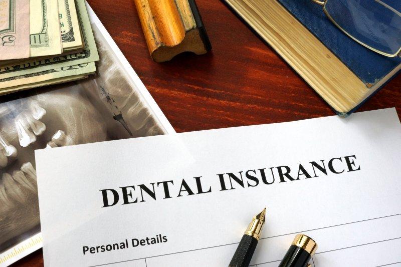 Dental insurance paperwork on desk